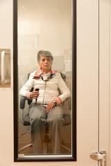 Senior woman in audiometry room