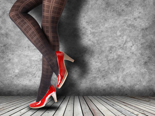 Woman's Legs Wearing Pantyhose and High Heels