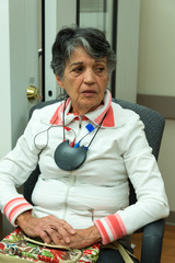 Senior woman in audiometry room