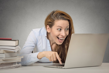 Funny female working on computer ready to press enter button