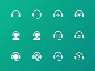 Earphones icons on green background.