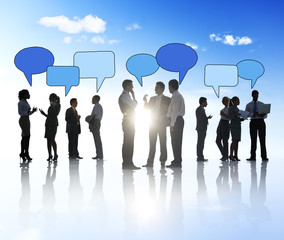 Business People Outdoors and Speech Bubbles