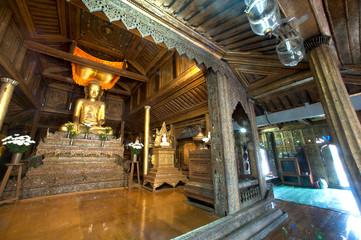 Golden Buddha inside at wood Church of Nyan Shwe Kgua temple.