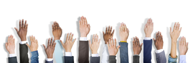 Diverse Business People's Hands Raised
