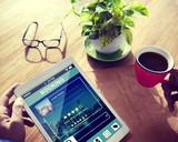 Fototapety Man Booking Hotel Reservation on Digital Tablet