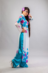 Beautiful asian woman wears a national dress