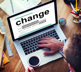 Man Reading the Definition of Change