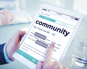 Man Reading the Definition of Community