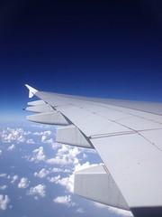 Air plane wings on a cloud