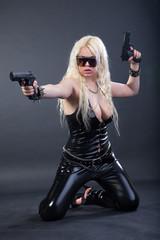 Beautiful sexy girl with guns