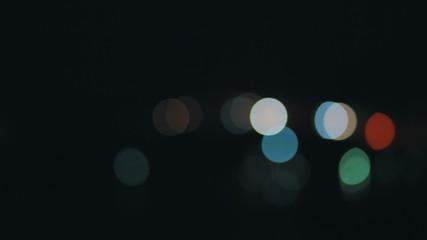 Circular defocused traffic lights at night.