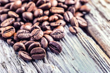 Coffee beans  on grunge wooden background.Macro