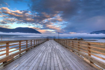 Salmon Arm Wharf on a cloudy morning sunrise.