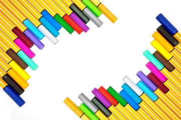 Colorful pens on isolated white background