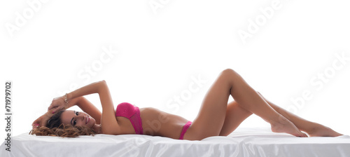 canvas print picture Studio shot of sexy lingerie model lying in bed