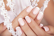 Beautiful woman's nails with french manicure. - 71979964
