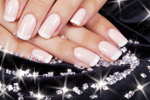 Papiers peints Manicure Beautiful woman's nails with french manicure and diamonds.