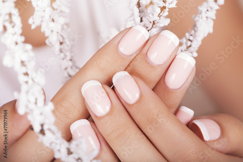 Poster, Tablou Beautiful woman's nails with french manicure.