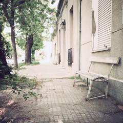 Vintage bench in a tranquil sidewalk