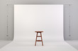 3d studio setup with wooden chair and white background