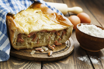 Pie with cabbage and sausages