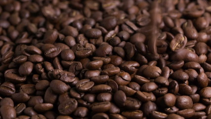 falling coffee beans closeup, made from raw