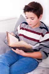 Boy reading the book