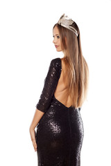 beautiful young woman with a crown and evening dress