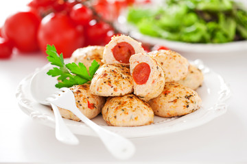 Chicken meatballs stuffed with cherry tomatoes, selective focus