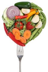 Gemüse und Früchte auf Gabel