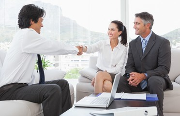 Businessman shaking a clients hand