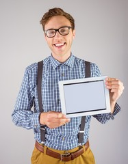 Geeky businessman showing his tablet pc