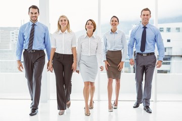 Business people walking together in office