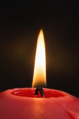 Close up of a red candle burning