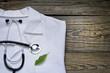 Alternative medicine stethoscope and green symbol background - 71985995