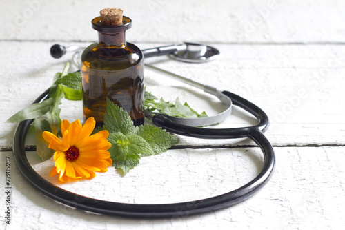 Alternative medicine herbs and stethoscope concept - 71985907