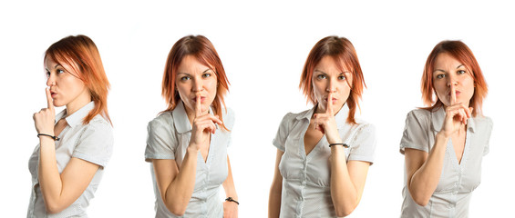 Young girl doing silence gesture over white