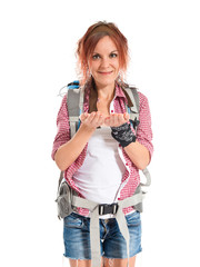 backpacker holding something over white background