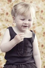 Cheeky young girl laughing in studio