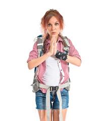 backpacker pleading over white background