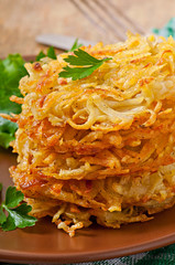 Fragrant potato pancakes with sour cream and herbs