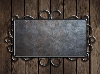 Old metal plate or sign on vintage wooden door