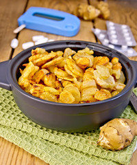 Jerusalem artichokes roasted in pan with meter and pills
