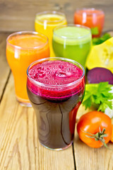 Juice beet and vegetable with vegetables on table