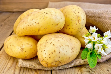 Potatoes yellow with flower on sacking