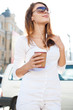 Relaxed stylish businesswoman looking away outside