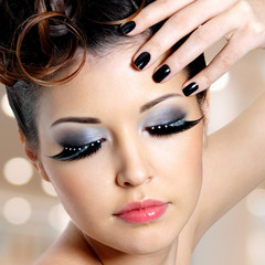 Face of  woman with  fashion eye makeup