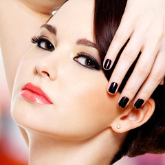 Glamour beautiful woman with black nails