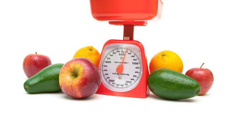 healthy food: fruits and kitchen scales. white background.