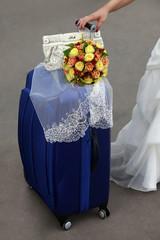Bride with blue suitcase